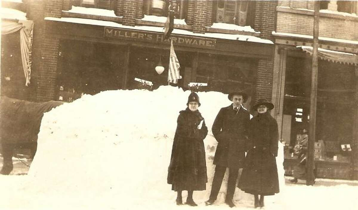 This early 1900s picture shows a snowy scene from in front of Millers Hardware on River Street.