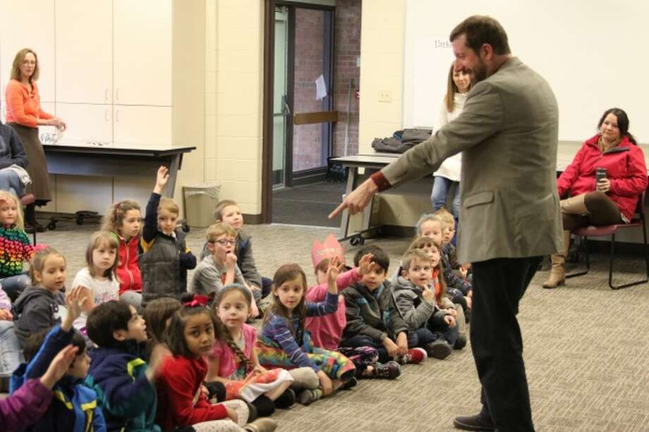 Sooper Yooper book author Mark Newman interacts with kindergarten students during the Manistee ISD Young Authors program on Thursday.