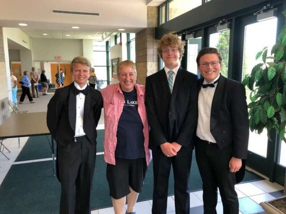 Manistee High School Band members (left to right) Seth Thompson, director Andrea Mack, Titus Lind and Ryan Biller performed with the Benzie Community Orchestra this summer.