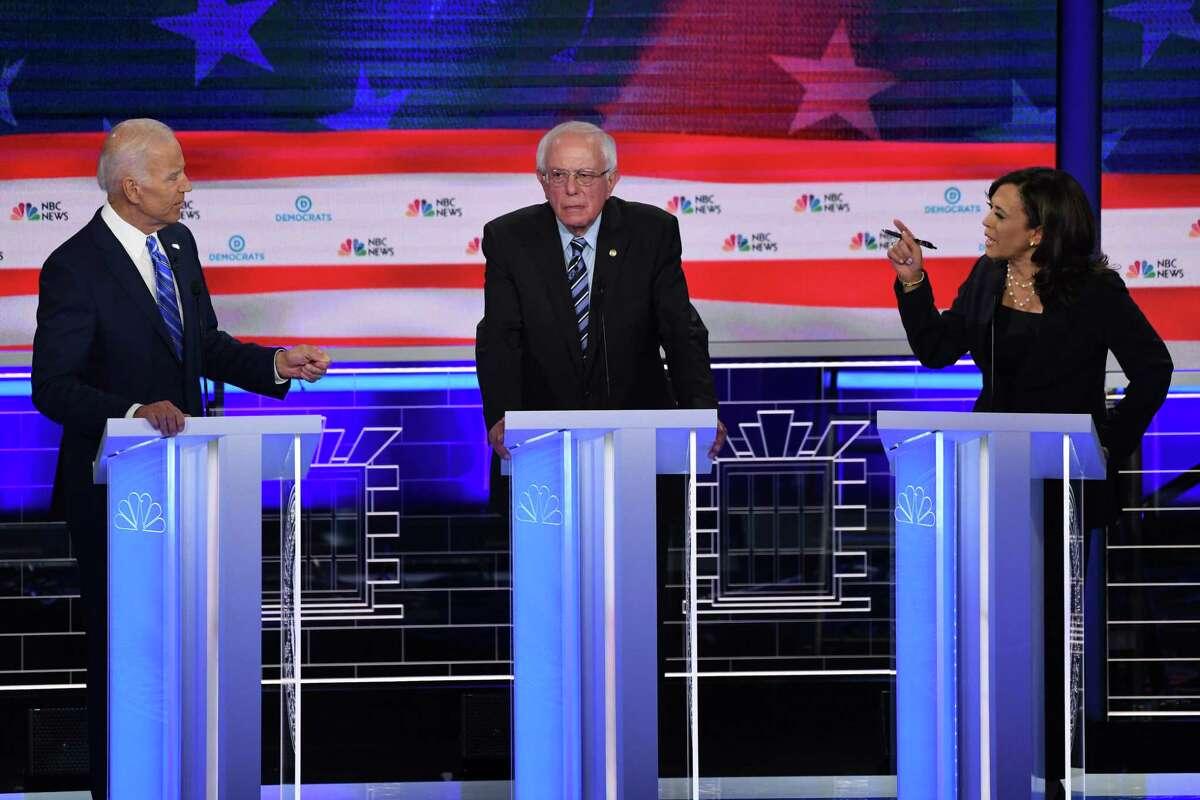 Democratic presidential hopefuls former Vice President Joe Biden, U.S. Sen. Bernie Sanders and U.S. Sen. Kamala Harris speak during the second Democratic primary debate of the 2020 presidential campaign season hosted by NBC News at the Adrienne Arsht Center for the Performing Arts in Miami.