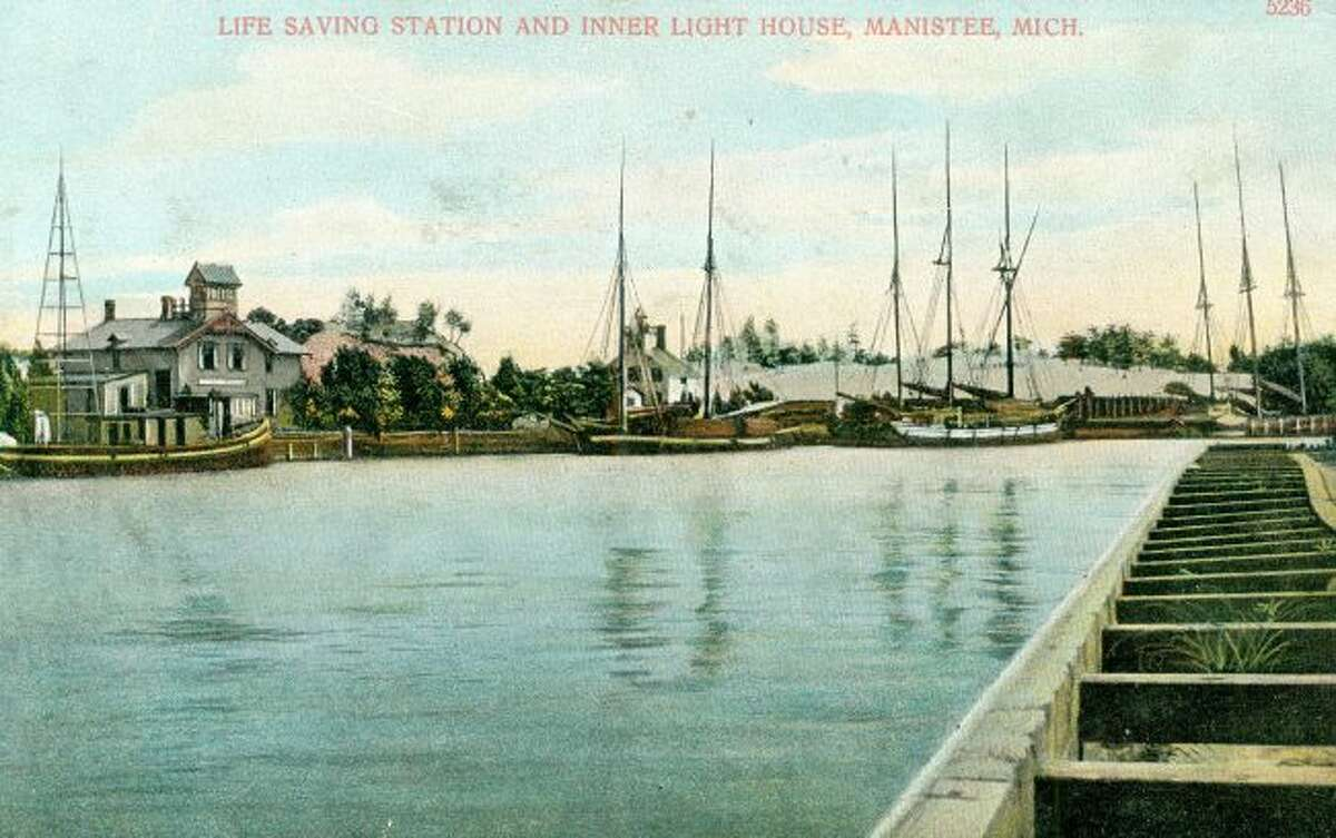 The Lifesaving Station which came before the U.S. Coast Guard Station at Fifth Avenue Beach is shown in this 1890s photograph. The building also include a second lighthouse type light on top of the building beyond the one that was located on the pier.