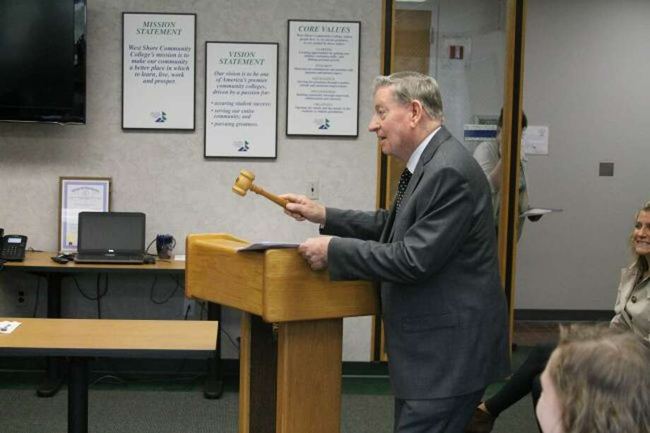 Dr. John Eaton who was the first president of West Shore College back calls Monday's board of trustees meeting to order by banging the original gavel that was used at the first board of trustees meeting on March 27,1967. When Eaton retired years later, the gavel was presented to him by the board of trustees.