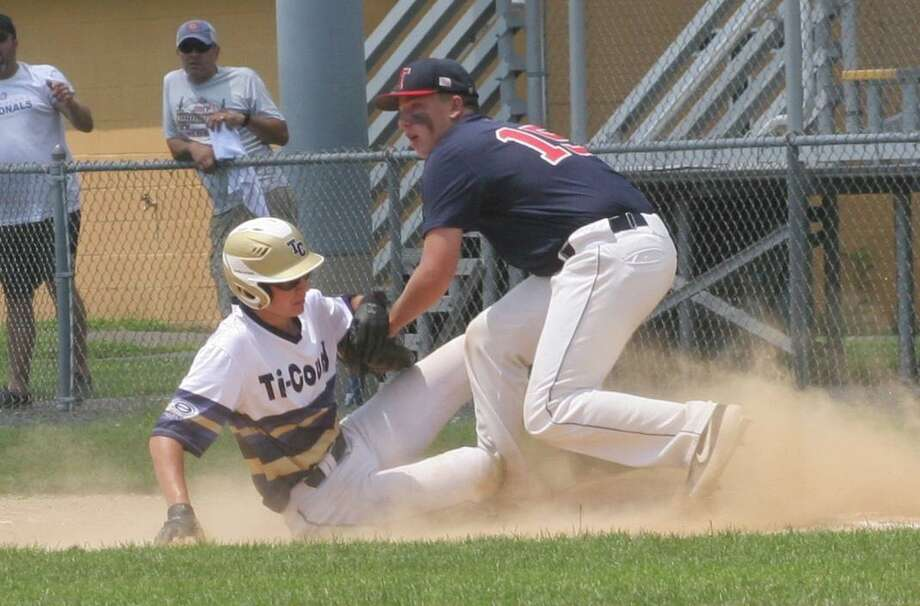 Post 141's Christian Van Zyl tags out Tri-County's Josh Wagner in the second inning of Trumbull's first-game win. Photo: Bill Bloxsom / Hearst Connecticut Media / Trumbull Times