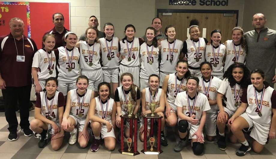 Players from the championship teams (front row) are: Maddie Wilkins (6th Grade), Remy DeNomme (6th Grade), Caitlyn Elmo (6th Grade), Molly Vicente (6th Grade), Katelyn Landin (6th Grade), Ava Mullen (6th Grade), Ryley Tate-Padian (6th Grade), Cheyenne Brand (6th Grade), Julia Johnson (6th Grade) and Abby Gruttadauria (6th Grade); (second row) Caroline Cummings (8th Grade), Madison Goncalves (8th Grade), Audrey Vacca (8th Grade), Ellie Lynch (8th Grade), Kendall Reilly (8th Grade), Maddie Lojko (8th Grade), Grace Trotta (8th Grade), LyNeta Brand (8th Grade), Megan Garrity (8th Grade) and Julia Bike (8th Grade); (third row) coach Chris Gruttadauria (6th Grade), Coach Brian Elmo (6th Grade), Coach Matt Landin (6th Grade), Coach Keith Lojko (8th Grade) and coach Nick Brand (8th Grade). Missing from photo are Nola Antonio (6th Grade), Olivia Delawder (6th Grade). Photo: St. Theresa School / Contributed Photo / Trumbull Times