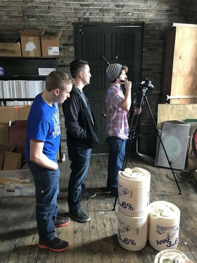 """Manistee High School video production class students film video on Friday that for which they are creating a virtual tour of the City of Manistee fire station. The video is being used by the local department to gain recognition as being the Guinness Book of World Records as the """"Oldest Continuously Manned Fire Station."""""""