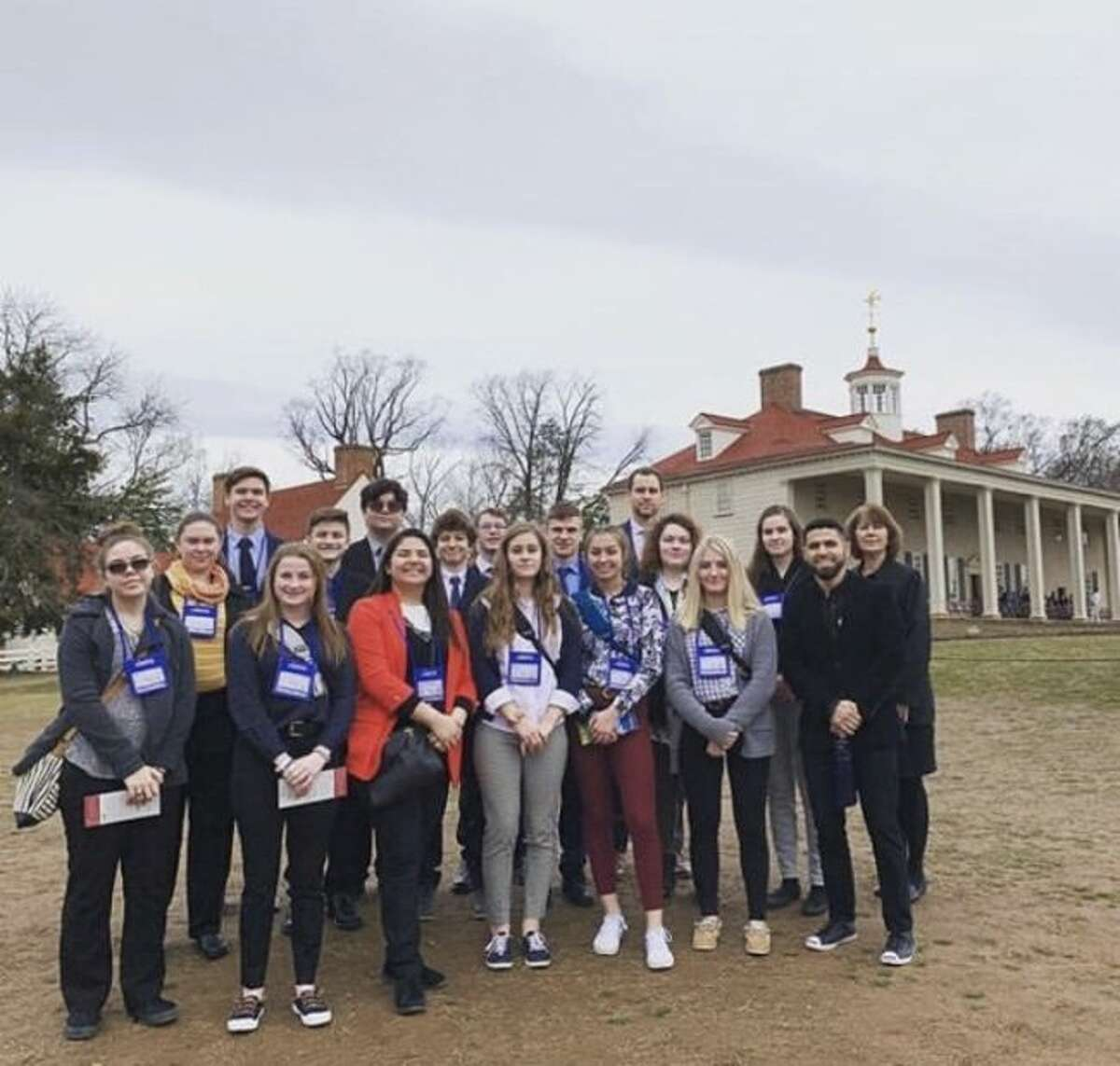 Manistee Catholic Central students pose proudly in front of George Washington's Mt. Vernon estate.