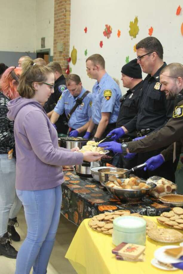 CASMAN Academy students celebrated their annual Thanksgiving Feast dinner on Tuesday at the school. Local members of law enforcement and fire departments worked as servers on the dinner that was prepared by staff and volunteers.