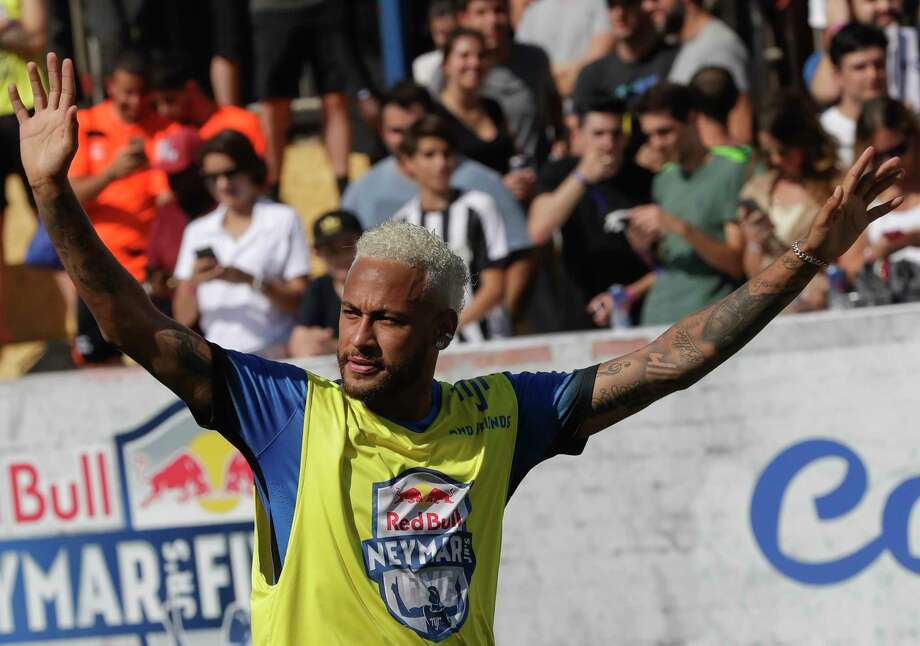 Brazilian soccer player Neymar acknowledges fans during the Neymar Jr's Five youth soccer tournament in Praia Grande, Brazil, Saturday, July 13, 2019. (AP Photo/Andre Penner) Photo: Andre Penner, Associated Press / Copyright 2019 The Associated Press. All rights reserved.