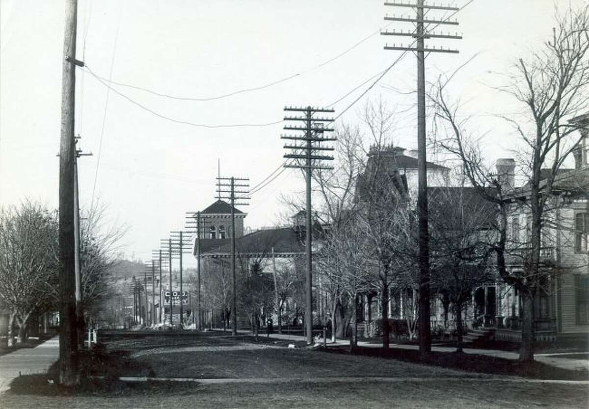 This 1905 photograph taken from the corner of the Third and Maple streets near the current location of the Manistee Courthouse building shows how the streets were not even paved at that time.