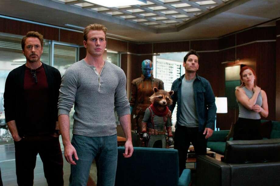 """An assortment of Avengers — Robert Downey Jr. (from left), Chris Evans, Karen Gillan, Rocket, Paul Rudd and Scarlett Johansson — assemble in a scene from """"Avengers: Endgame."""" Photo: Disney / Disney/Marvel Studios"""
