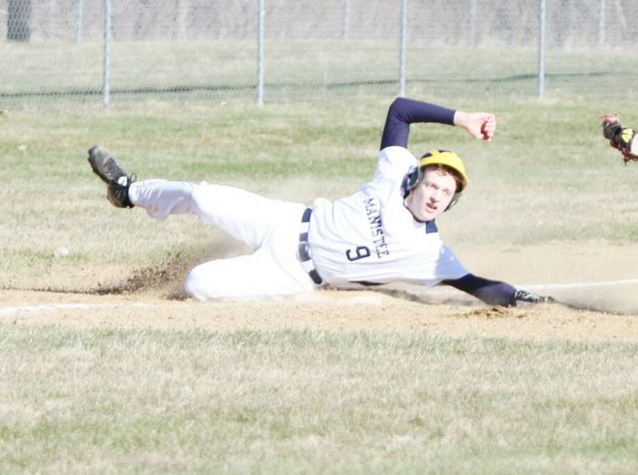 Manistee's Andrew Jackoviak slides safely into third while stealing the base Friday against Orchard View. (Kyle Kotecki/News Advocate)