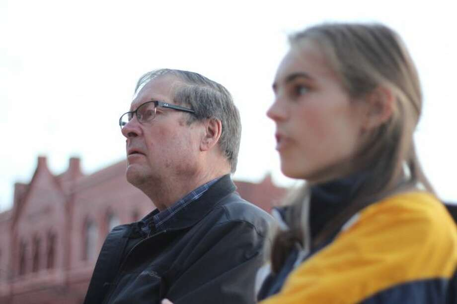 MHS student Solana Postma and county commissioner Gene Lagerquist stand before the crowd of protesters gathering at Manistee City Hall. (Scott Fraley/News Advocate)