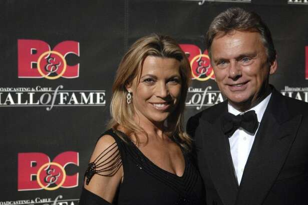 """Game Show Host's Vanna White and Pat Sajak arrive at the 17th annual Broacasting and Cable Hall of Fame awards dinner Oct. 22, 2007, at Cipriani's 42nd street, in New York. Hillsdale College in Michigan says the """"Wheel of Fortune"""" host will lead the governing board at the small liberal arts school. ( AP Photo/Peter Kramer, File)"""