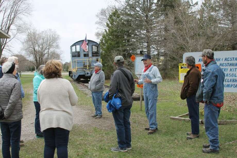 History and railroad enthusiasts took a tour of the Manistee and Northeastern railroad grade route on Saturday with a stop at the Kaleva Depot. Sonny Miller offers some information about the depot and the area. (Michelle Graves/News Advocate)