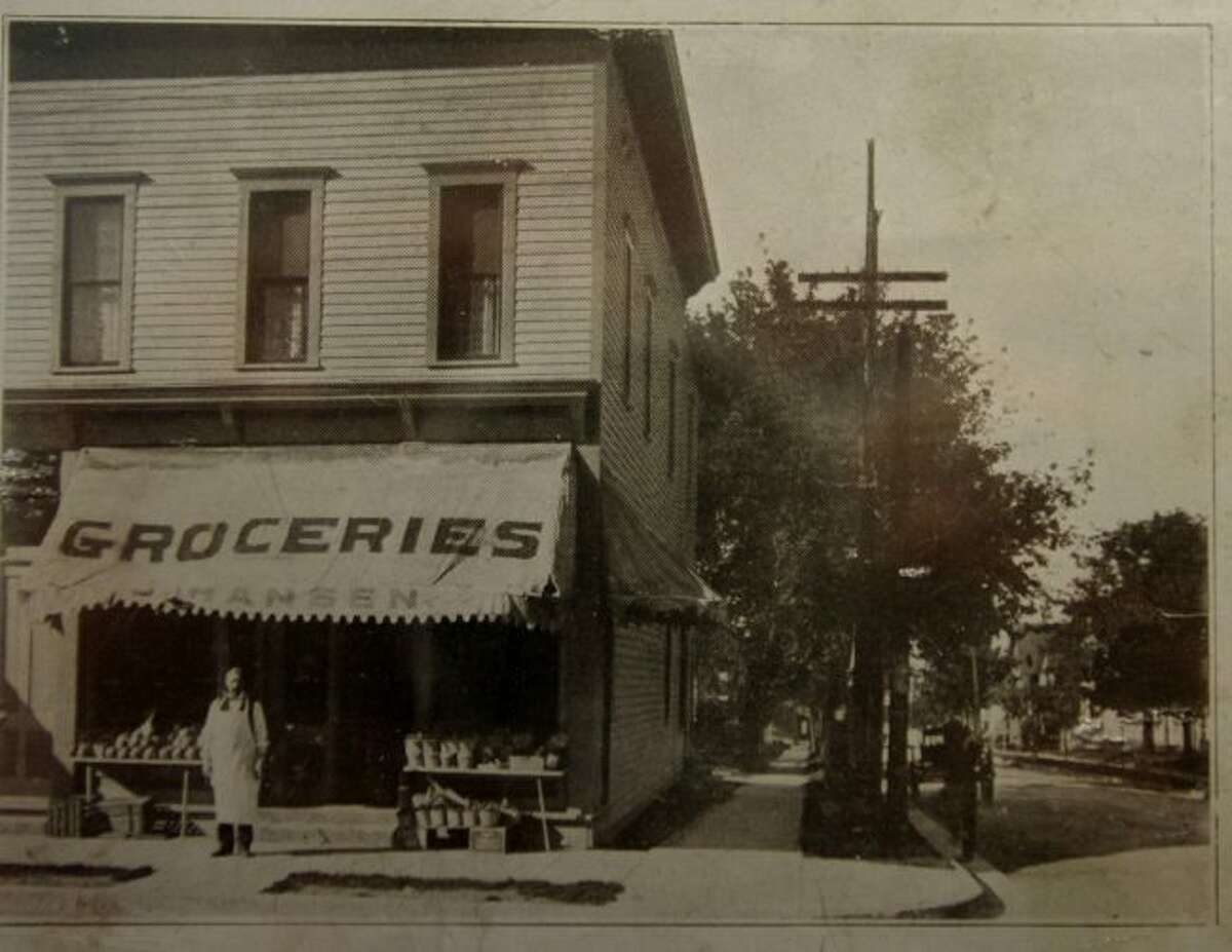 The building presently owned by Veach and Allen Optometry on First Street is shown in this photograph from the 1920s when it was Hansen's Grocery Store.
