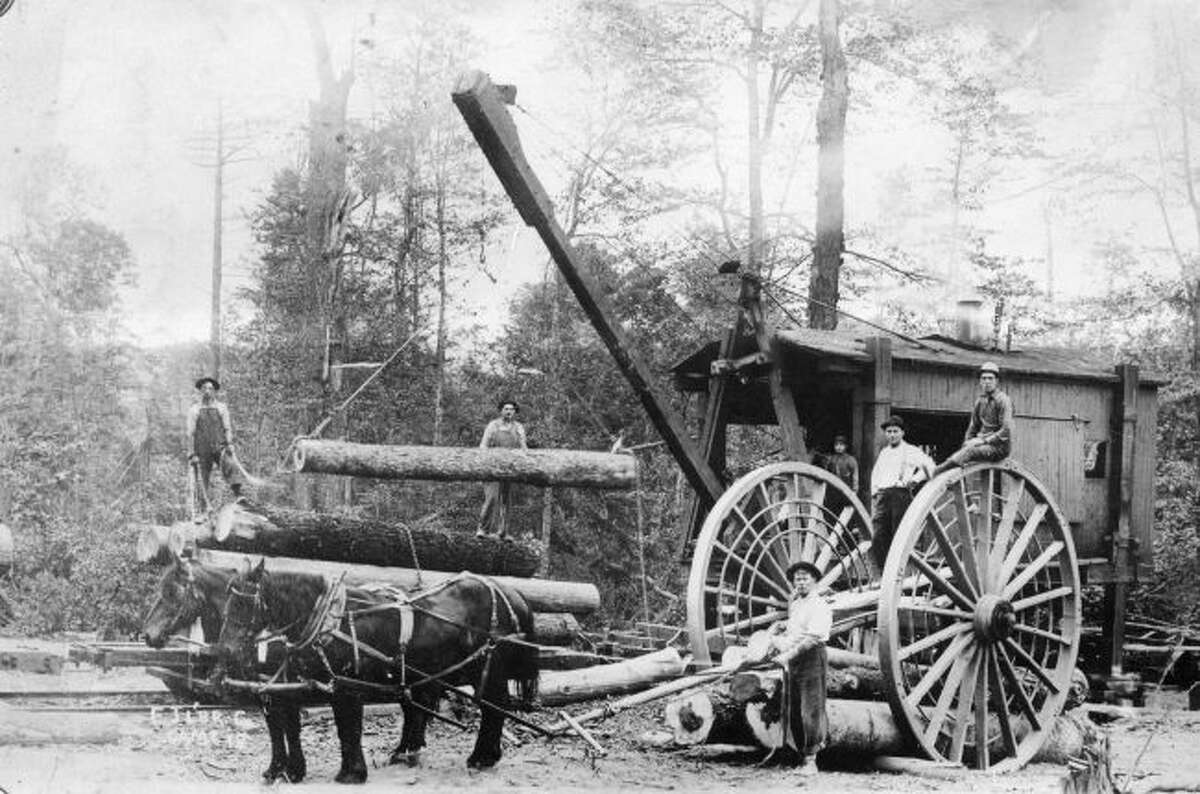Shown is some of the early equipment used in the logging industry. Silas Overpack wheels transported the logs out of the woods where cranes from that time would lift them on to narrow gauge railroads for shipment to the sawmill.