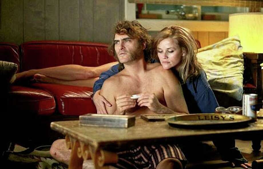 "Joaquin Phoenix and Reese Witherspoon are among the featured players in the adaptation of Thomas Pynchon's novel, ""Inherent Vice."" Photo: Contributed Photo / Contributed Photo / Westport News"
