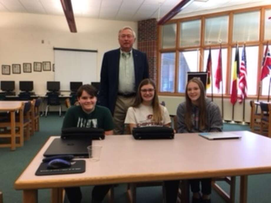 These are the contributors to Onekama Middle School's Writers' House. Seated, left to right, Ryan Petrosky, Mairin McCarthy, Maegan Hrachcovina. Standing is John Wemlinger.