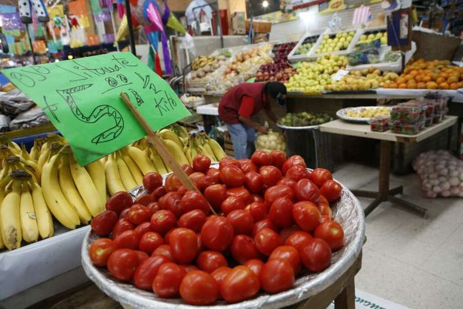 FILE - In this Feb. 2, 2017 file photo, Mexican tomatoes are displayed for sale at a produce stand in Mercado Medellin in Mexico City. Mexico's Economy Department said Tuesday, May 7, 2019 that U.S. consumers could pay 38% to 70% more for tomatoes after the U.S. Commerce Department announced it would re-impose anti-dumping duties of 17.5% on Mexican imports. (AP Photo/Rebecca Blackwell, File)