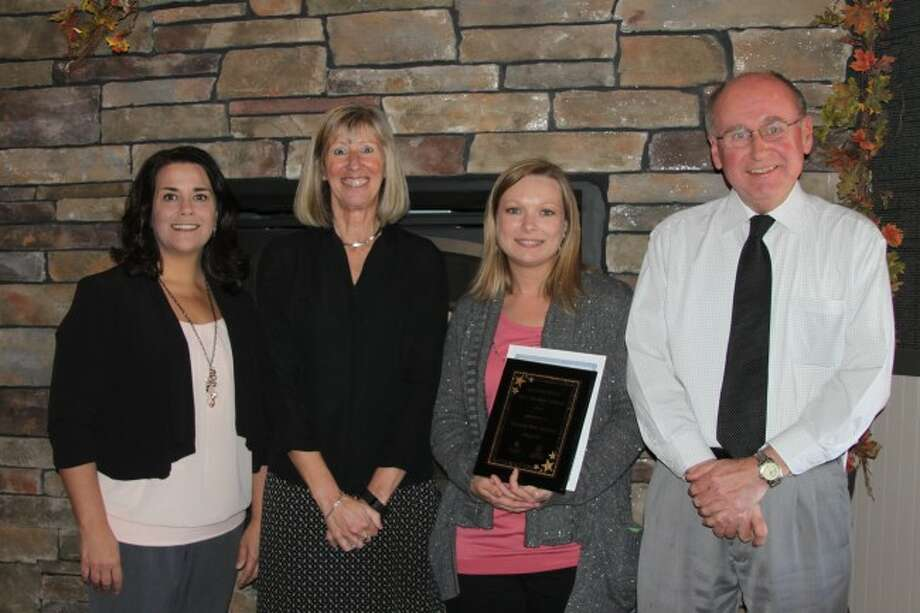 The Manistee News Advocate was presented the 2016 Early Childhood Champion Award at the Manistee County Early Childhood luncheon for its support of preschool to college education programs. The luncheon was sponsored by the Start Collaborative and Launch Manistee. Shown left to right are Great Start Collaborative's Patti Borucki, Launch Manistee program director Mary Ann Behm, Manistee News Advocate Managing Editory Michelle Graves and education writer Ken Grabowski.