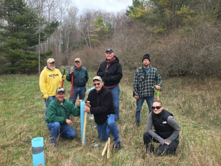 Volunteers helped plant about 100 trees at Magoon Creek Natural Area recently. Pictured (front row, left to right) are Bob Skiera, Terry Walker, Invasive Species Network invasive species specialist Audrey Menninga; (back row) Kirk Hayden, Jim Robke, Roger Dittmer and Paul Olen. (Courtesy photo/Fields Ratliff/ISN)