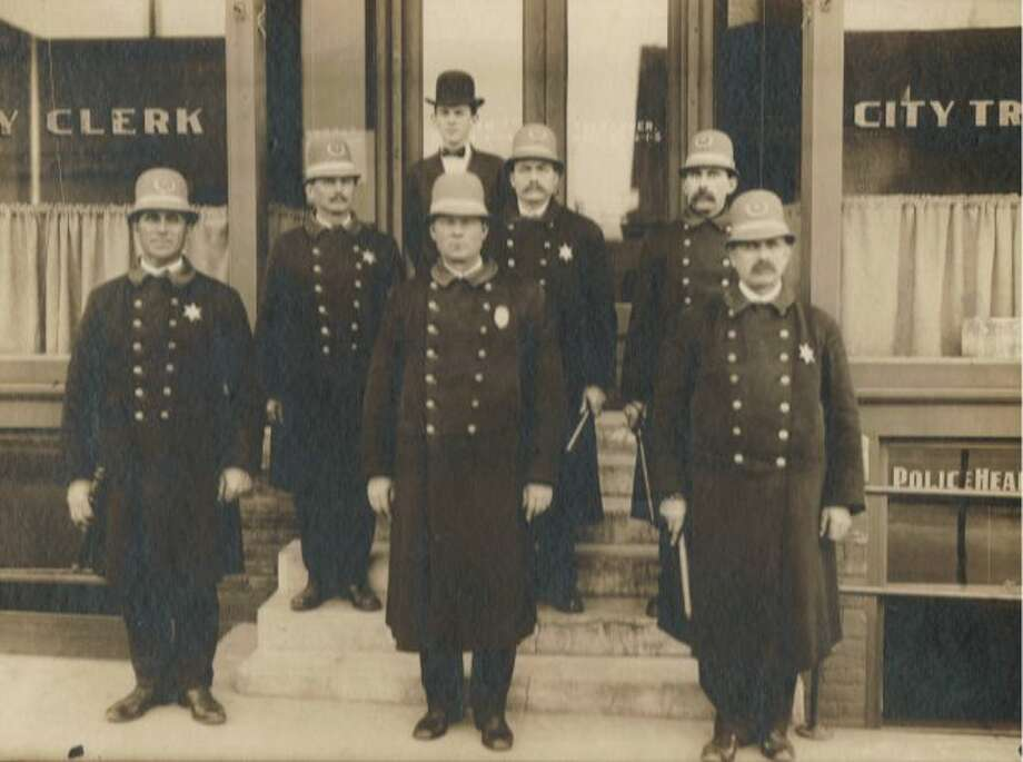 Members of the City of Manistee Police force are shown in this photograph from the early 1900s.