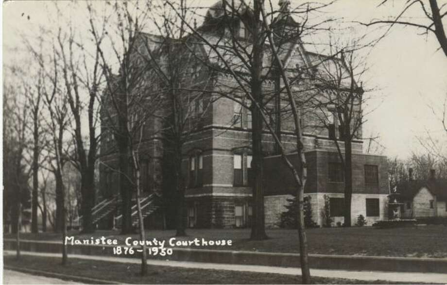 The old Manistee County Courthouse building is shown in this early 1900 photograph.
