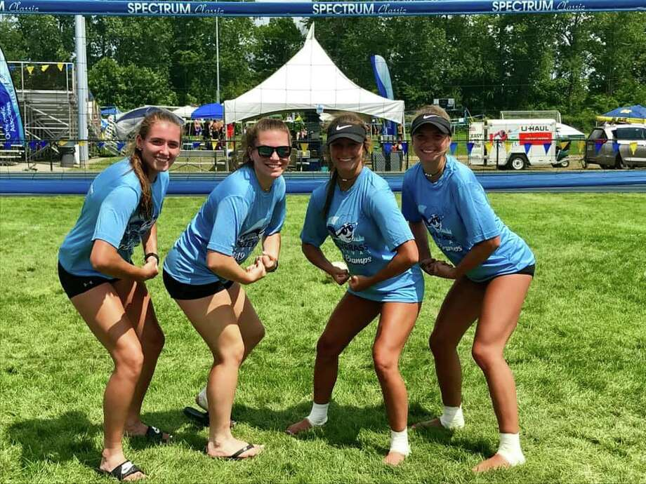 From left, Harbor Beach volleyball stars Makayla Roberts, Kirsten Stein, Claire Woodke, and Amber Pleiness pose in their championship shirts after winning the Blue Water Volleygrass tournament in Port Huron. Photo: Photo Courtesy Of Julie Liedke