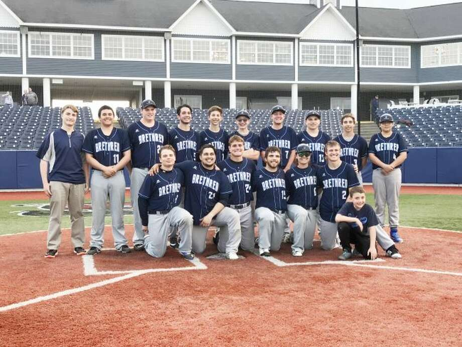 The Brethren baseball team poses on home plate at Wuerfel Park in Traverse City. The Bobcats split a doubleheader against Pine River. (Courtesy photo)