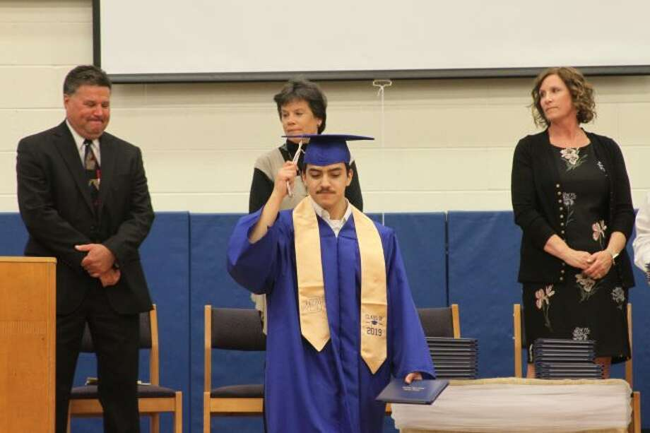 Seniors moved their tassels from right to left as a sign they were officially graduated. (Ashlyn Korienek/News Advocate)
