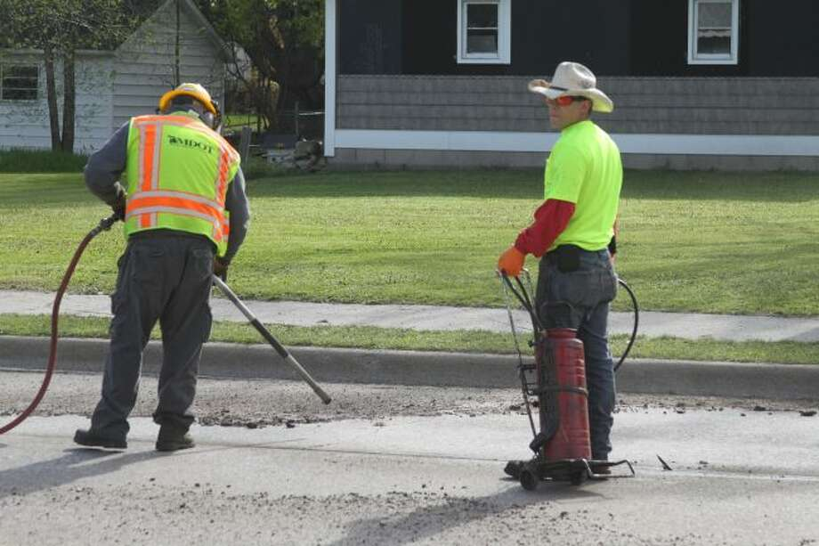 MDOT road crews were performing crack seal work on Tuesday on the southern end of U.S. 31 in the City of Manistee. (Ken Grabowski/News Advocate)