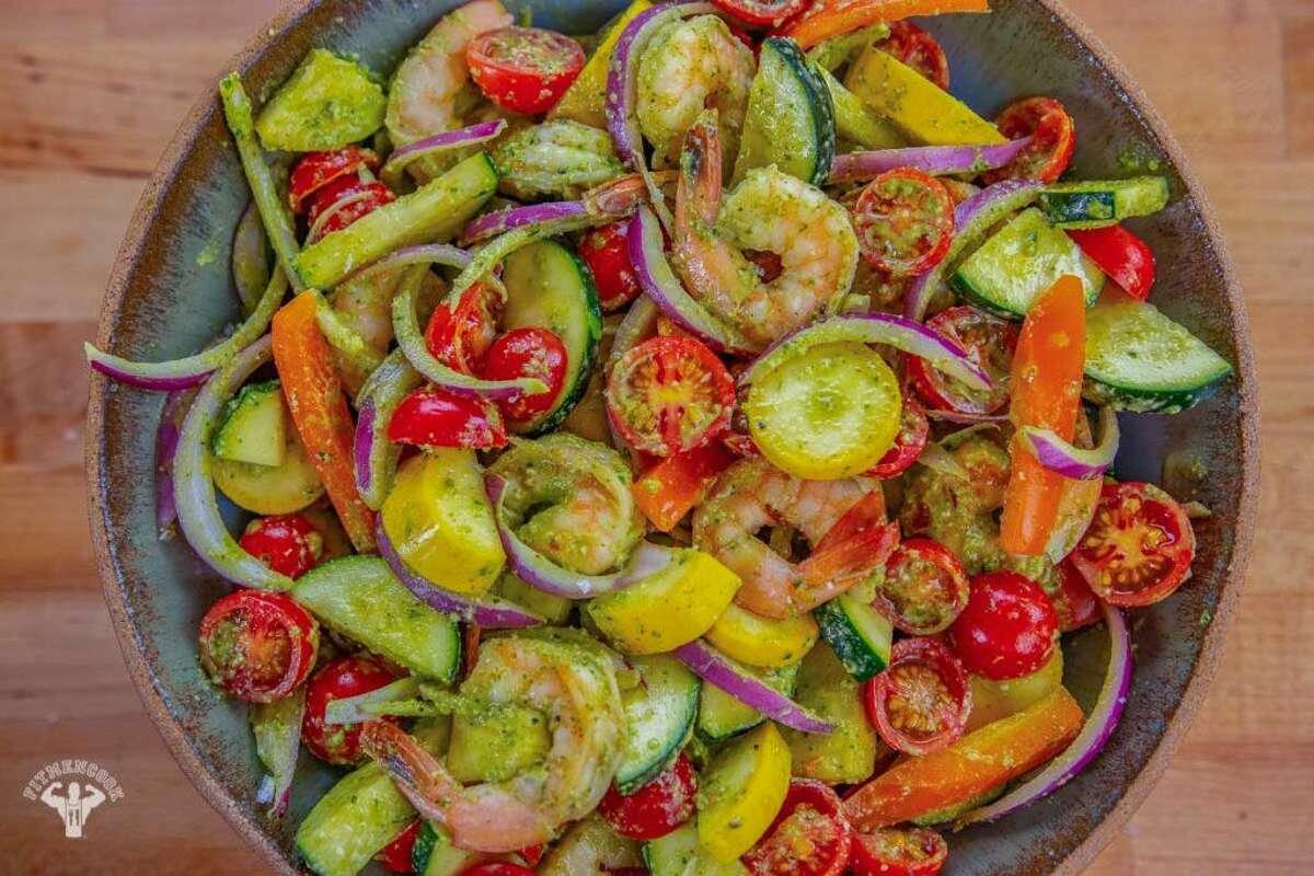 Arugula pesto salad with shrimp Kevin Curry, a Dallas native, published