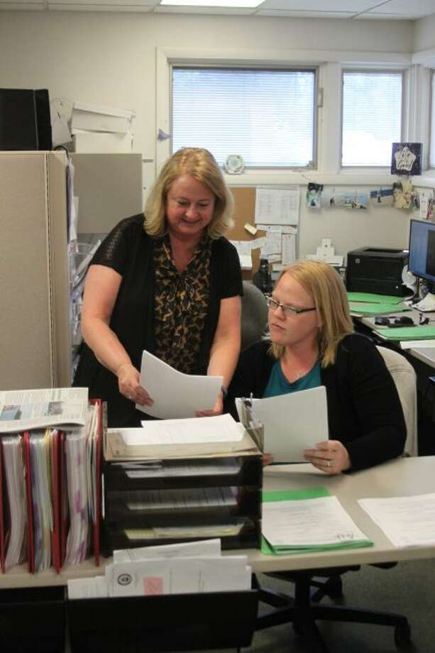 Manistee County Clerk Jill Nowak and chief deputy clerk Lindsey Marquardt review information prospective board of education and West Shore Community College Board of Trustee candidates will have to fill out to get their name on the November ballot.