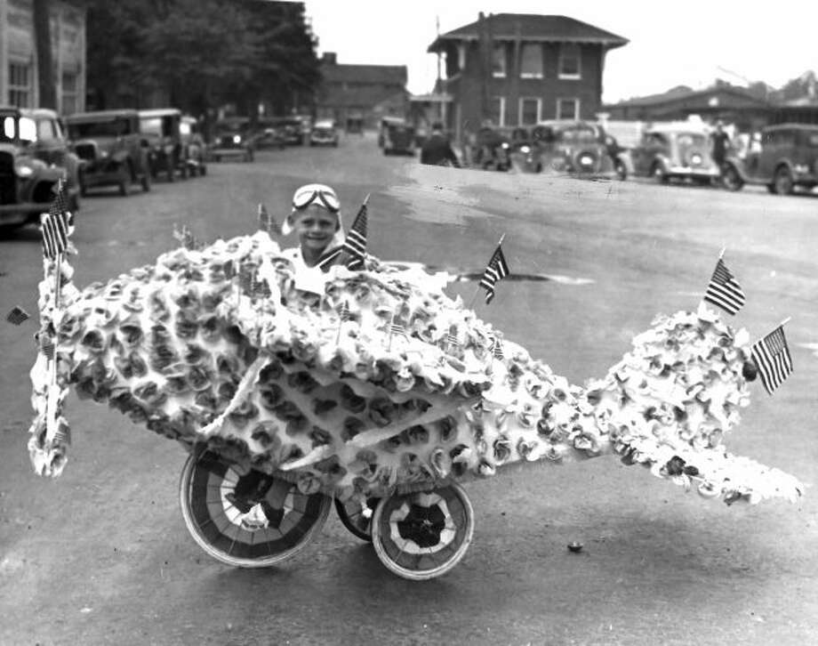 This entrant in a 1930s Fourth of July Parade in Manistee was all smiles for the camera.
