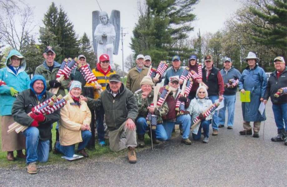 Catholic War Veterans Stephen T. Duchon Post No. 1847 members and friends placed 1,470 American flags on veterans' graves on Monday in Mount Carmel and Trinity Lutheran cemeteries in Manistee. (Courtesy photo)