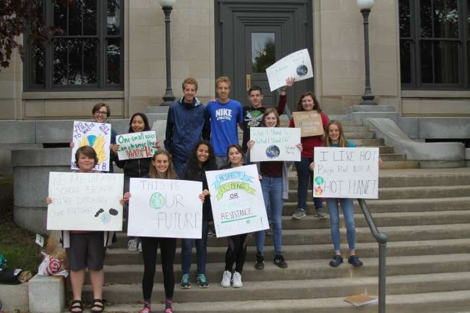More than 30 students gathered on the steps of the Manistee City Hall on Friday morning, joining other students around the world to show concerns over the environment.