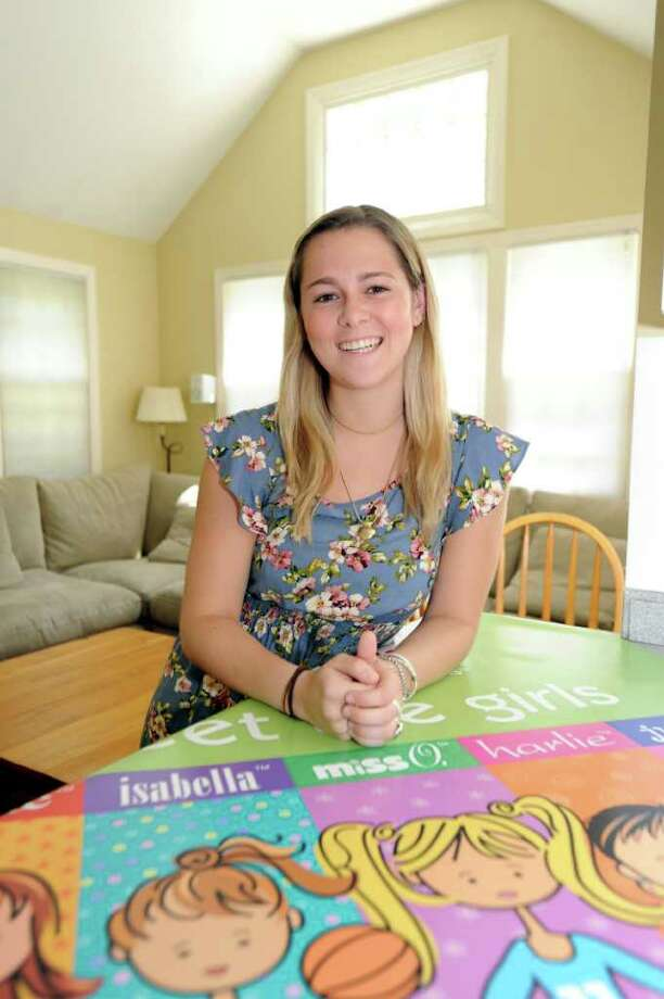 Juliette Brindak, 21, co-founder and CEO of missoandfriends.com, a viral website that started up in 2005, at home.  Julie sits in the family room on Monday, August, 2, 2010. Photo: Helen Neafsey / Greenwich Time