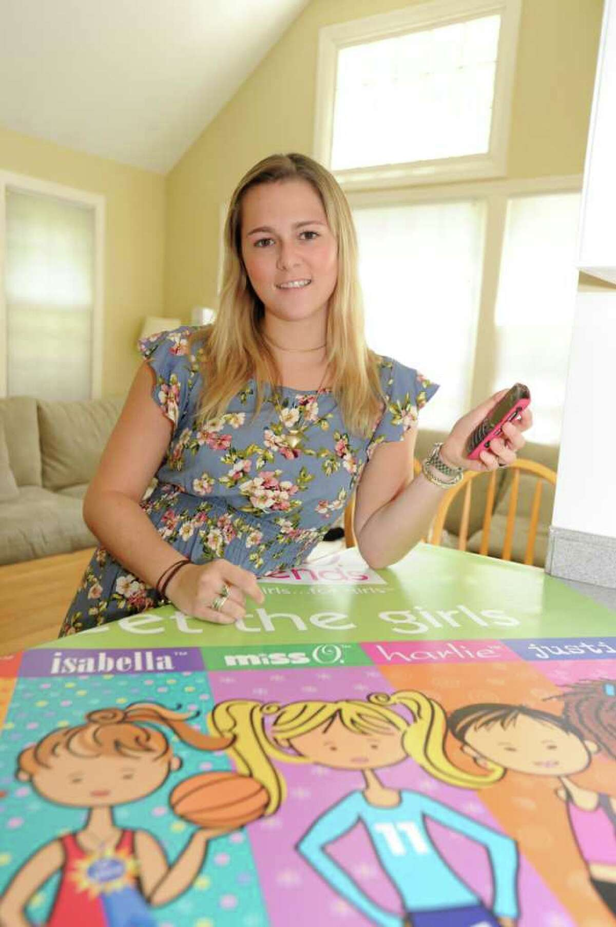 Juliette Brindak, 21, co-founder of missoandfriends.com, a viral website that started up in 2005, at home. Julie, who recently took the helm as CEO, sits with her Blackberry in the family room, on Monday, August 2, 2010.