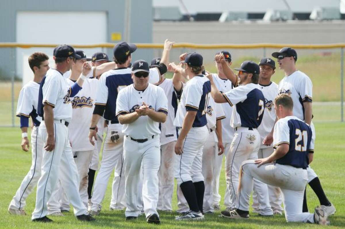 Manistee Saints manager Tyrone Collins breaks from a post-game team huddle earlier this summer. (News Advocate file photo)
