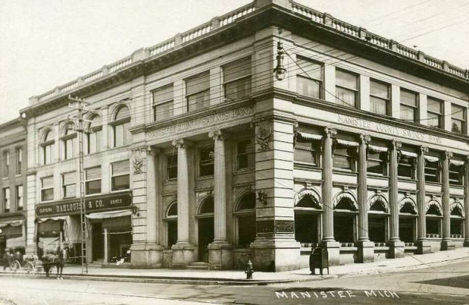 The Manistee County Savings Bank looked much the same in the early 1900s as it does today with the exception of some patrons arriving at the building in a horse and buggy.