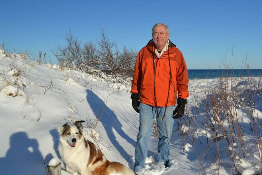 Author John Wemlinger, a retired Army colonel, his wife, Diane, and their border collie, Sydney, live in Onekama. (Courtesy photo)