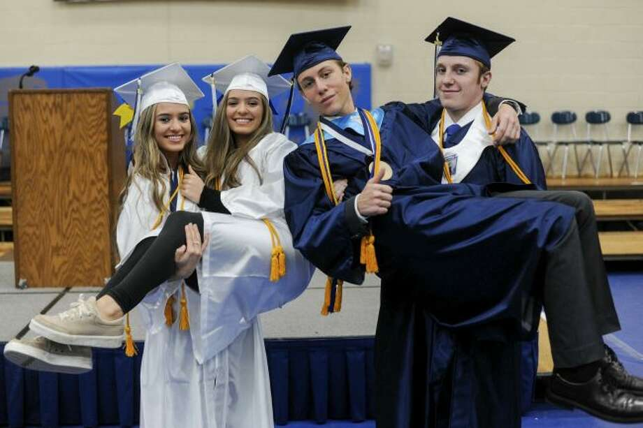 Identical twins Kayla and Maria Bolton and fraternal twins Connor and Barrett Bagby pose for a photo at Grass Lake High School on Friday, May 31, 2019. The two sets of twins are both graduating at the top of the Grass Lake High School senior class and will be attending the University of Michigan in the fall. (Mary Lewandowski/Jackson Citizen Patriot via AP)