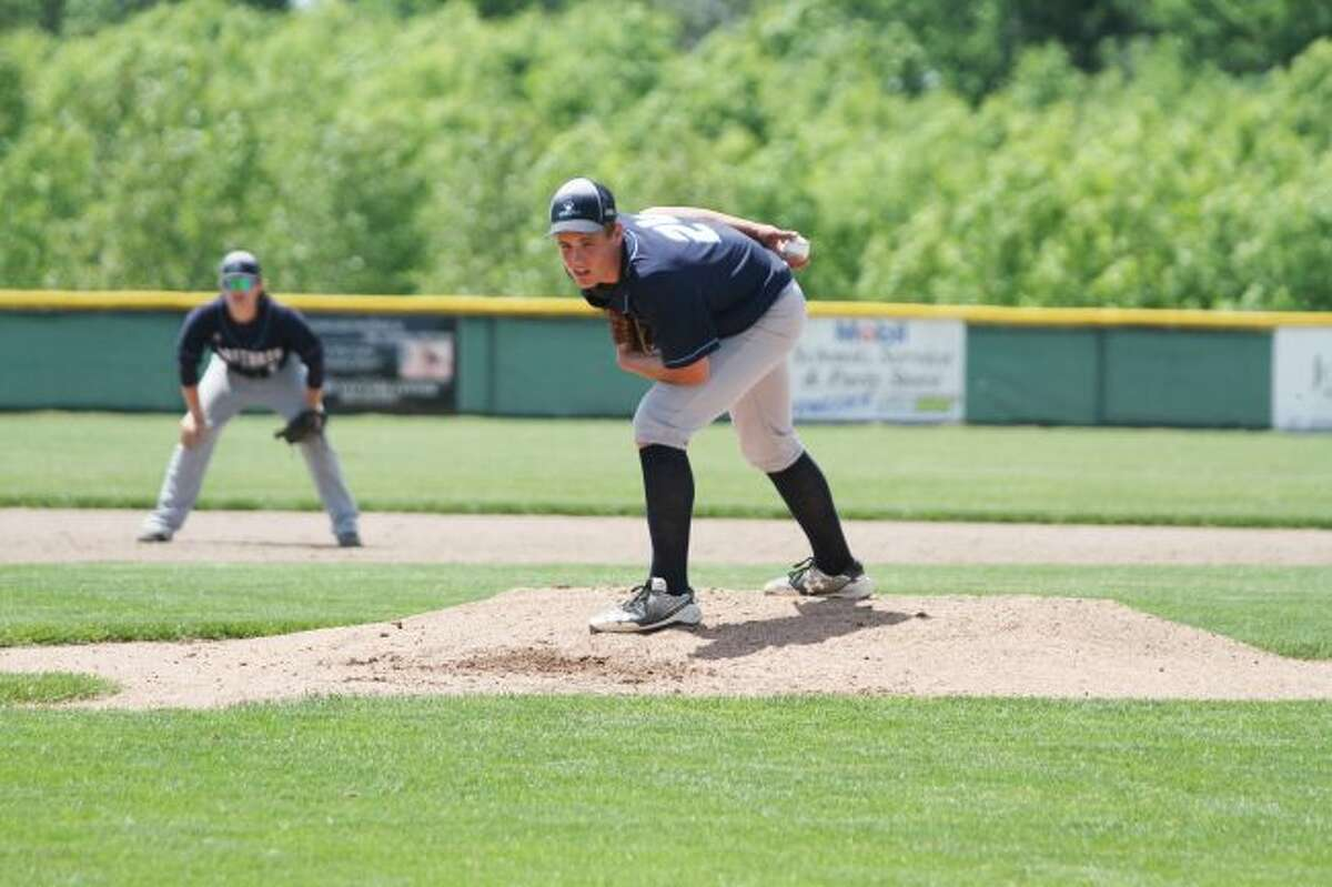 Brethren's Jake Riggs prepares to deliver a pitch during the Bobcats' regional semifinal against Beal City in Fowler on Saturday. (Dylan Savela/News Advocate)