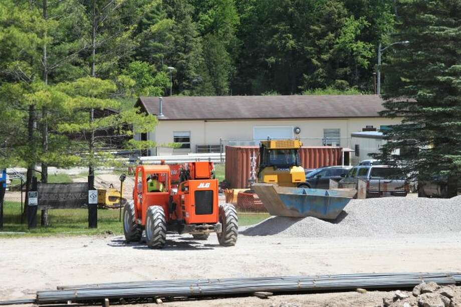 The Little Manistee River Weir upgrades have begun as equipment mobilized on Tuesday. (Ashlyn Korienek/News Advocate)
