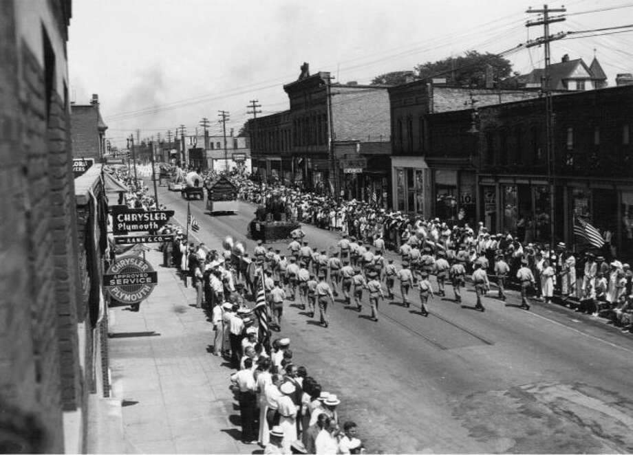 A Fourth of July Parade in downtown Manistee is shown in this early 1900 photograph.