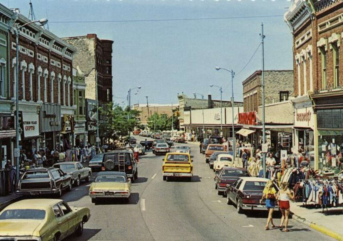 There was plenty of activity on River Street during this late 1970s sidewalk sale.