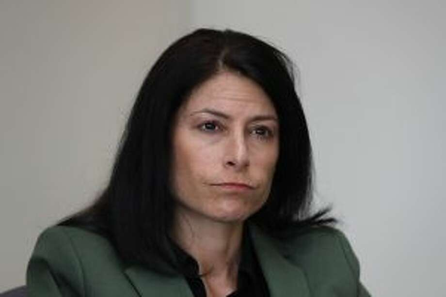 Dana Nessel, Attorney General of Michigan, listens to a question from reporters in Detroit on June 4. (AP Photo/Paul Sancya)