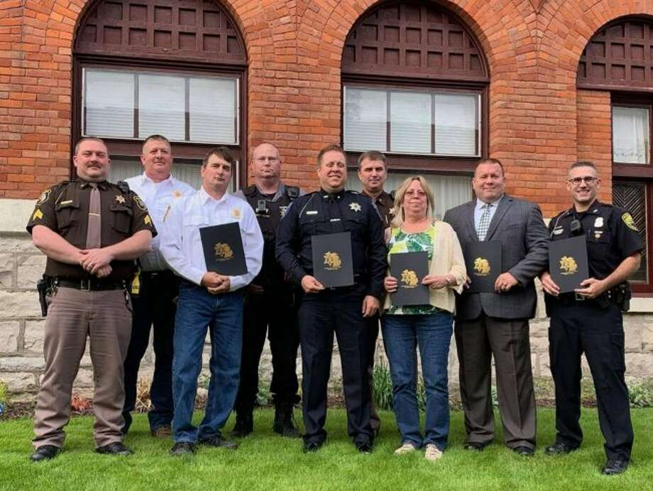 Manistee County sheriff John O'Hagan recognized ten people for their lifesaving efforts in 2018 on Tuesday. Pictured (from left to right) are those awarded Jason Torrey, Scott Cameron, Randy McCollum, J.R. Nelson, David Rodriguez, sheriff John O'Hagan, Bethany Carrier, Christopher Codden and Jason Hallead. Not pictured: Alex Schajter. (Courtesy Photo)