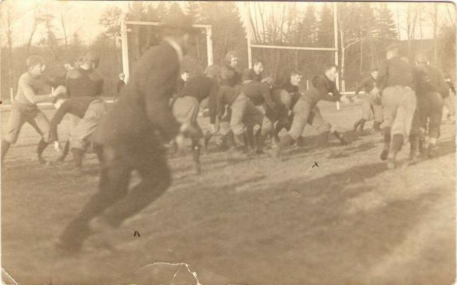 This photograph of the early 1900s shows the Manistee High School football team in action.