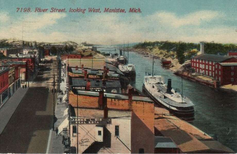 This photograph from the early 1900s shows the River Street area and the Manistee River Channel.